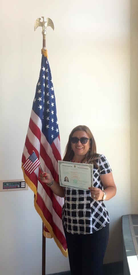 Citizens receiving their Citizenship Certificate